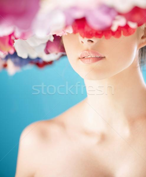 Portrait of a woman with a colorful wreath Stock photo © konradbak