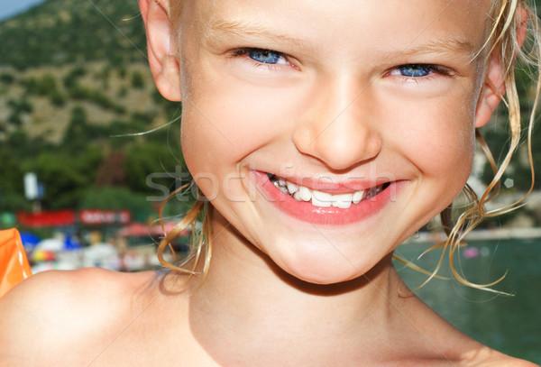 Young girl on sunny vacation day Stock photo © konradbak