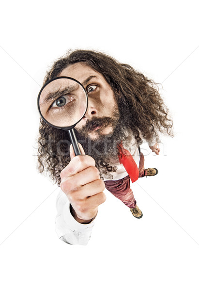 Fish-eye image of a worker holding a magnifier Stock photo © konradbak
