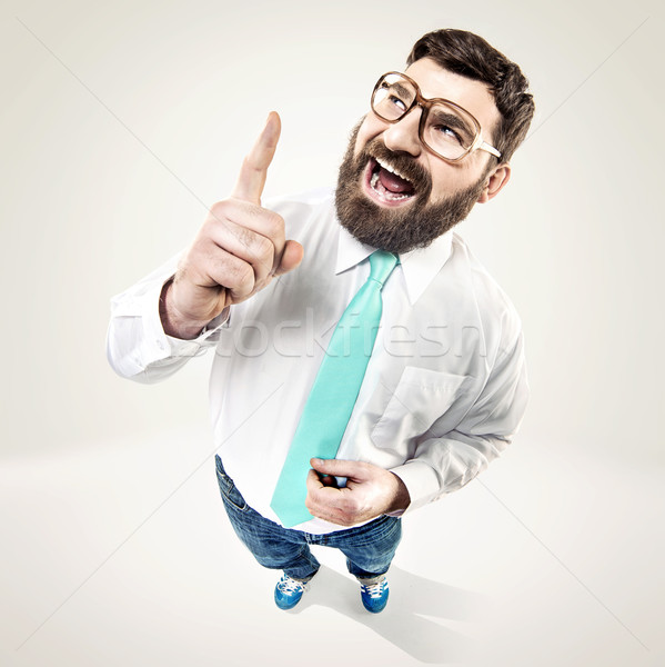 Excited nerdy guy raising his finger Stock photo © konradbak