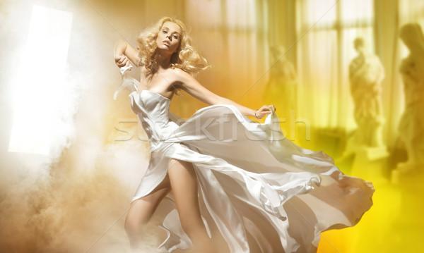 Aranyos szőke nő pózol fehér ruha nap Stock fotó © konradbak