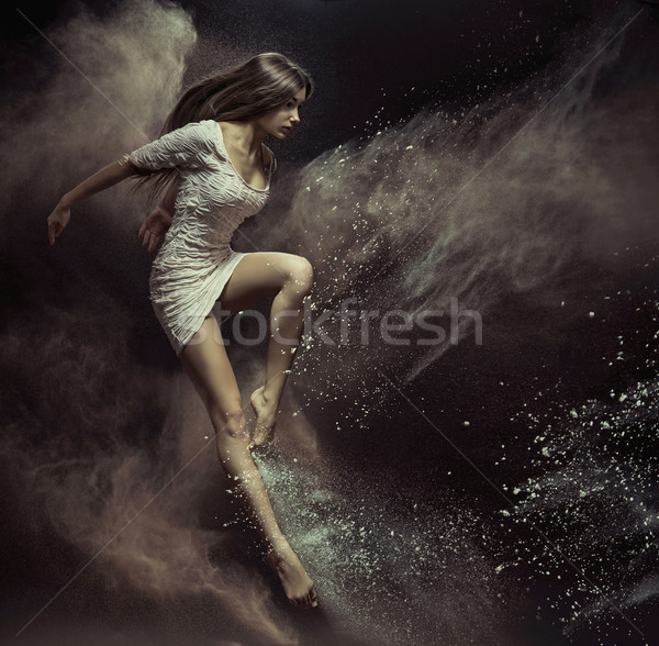 Jumping girl in full of dust place Stock photo © konradbak