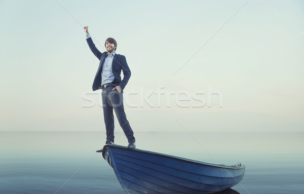 Wesoły młody człowiek malutki łodzi młodych facet Zdjęcia stock © konradbak