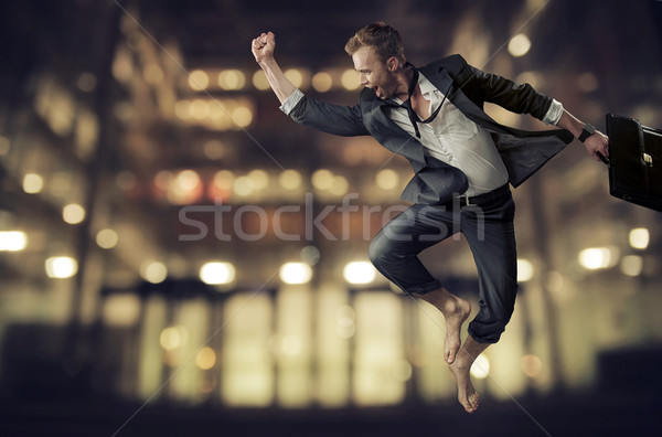 Handsome young businessman achieving a success Stock photo © konradbak