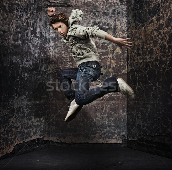 Fiatal hiphop táncos grunge fal férfi Stock fotó © konradbak