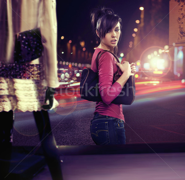 Walking woman looking at shop window Stock photo © konradbak