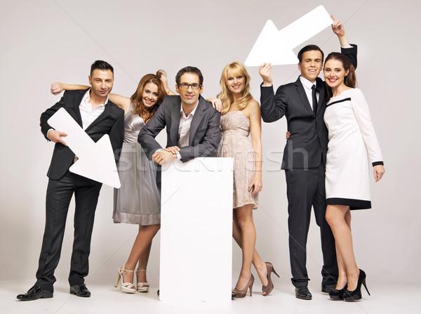 Group of attractive people pointing vectors Stock photo © konradbak
