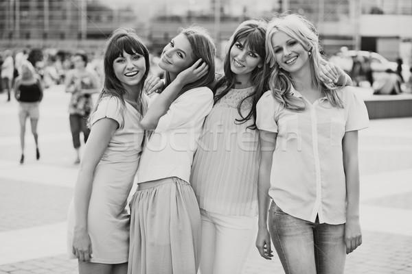 Black&white photo of the cheerful girls Stock photo © konradbak