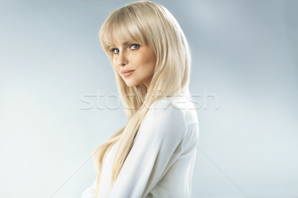 Delicate blonde woman with fabulous complexion Stock photo © konradbak