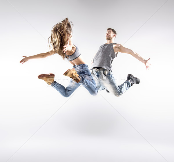 Talented hip-hop dancers practising together Stock photo © konradbak