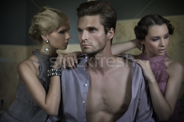 Two women and an handsome guy Stock photo © konradbak