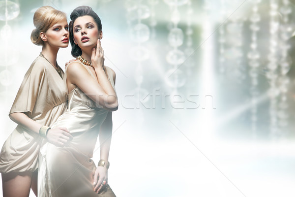 Two sexy women hugging Stock photo © konradbak