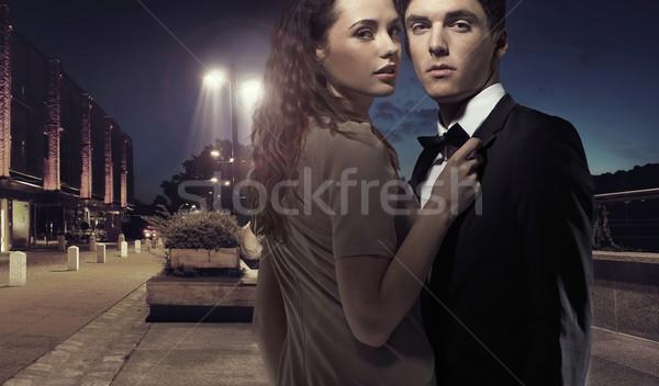 Elegante notte attrattivo felice bacio Foto d'archivio © konradbak
