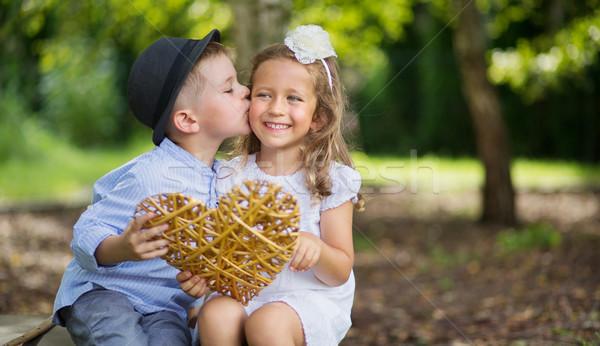 Great portrait of two kissing kids Stock photo © konradbak
