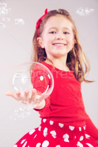 девочку большой мыльные пузыри мало женщину Сток-фото © konradbak