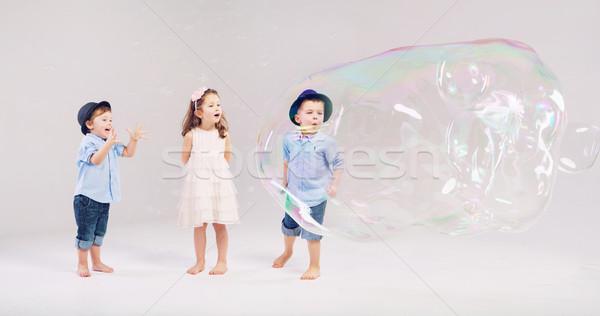 Dois pequeno cavalheiros jogar amigo bonitinho Foto stock © konradbak