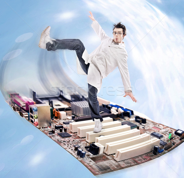 Funny looking madman scientist on a motherboard  Stock photo © konradbak