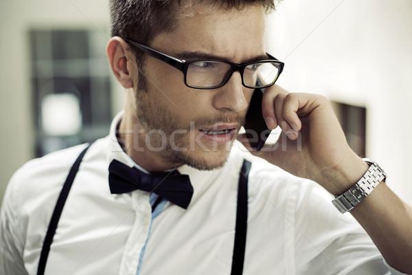 Closeup portrait of a phoning man Stock photo © konradbak