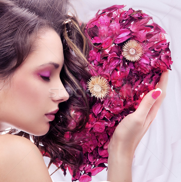 Portrait of a young beauty with rose heart Stock photo © konradbak