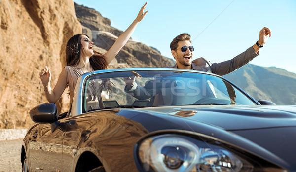 Smart couple riding a luxurious convertible Stock photo © konradbak