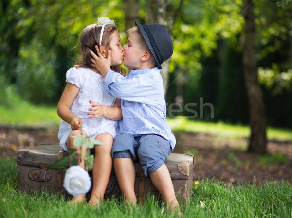 Cute para dzieci całując inny dzieci Zdjęcia stock © konradbak