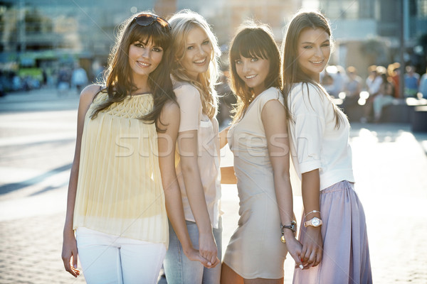 Four beautiful ladies in casual pose Stock photo © konradbak
