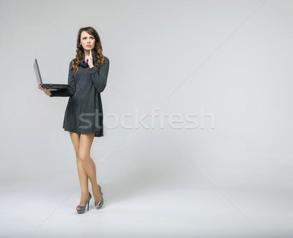 Astonished brunette lady with notebook Stock photo © konradbak