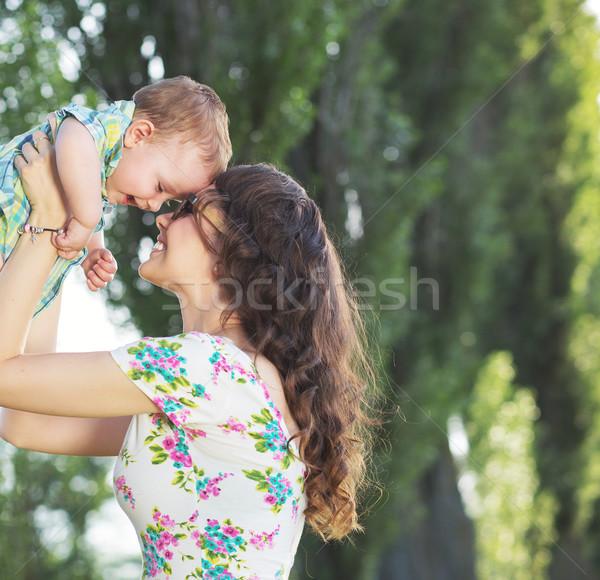 Tender mom tossing her child Stock photo © konradbak
