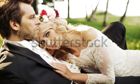 Delicate bride with handsome groom Stock photo © konradbak