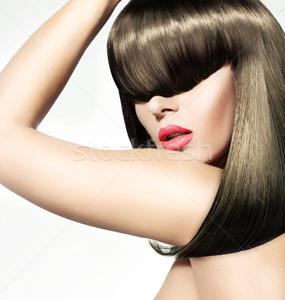 Beautiful ypung woman with bushy hairstyle Stock photo © konradbak