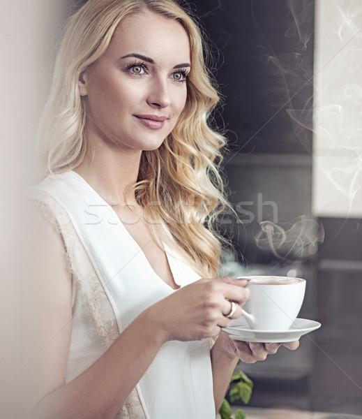 портрет довольно блондинка питьевой Кубок кофе Сток-фото © konradbak