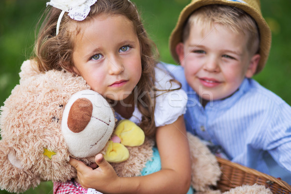 Glad kids holding cute teddy bear Stock photo © konradbak