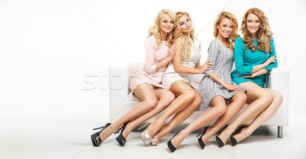 Four attractive ladies posing together Stock photo © konradbak