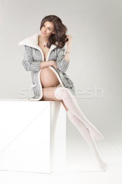 Tender pregnant woman wearing knee-lenght socks Stock photo © konradbak