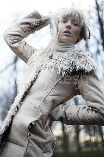 Portré vonzó lány visel fehér szőr lány Stock fotó © konradbak