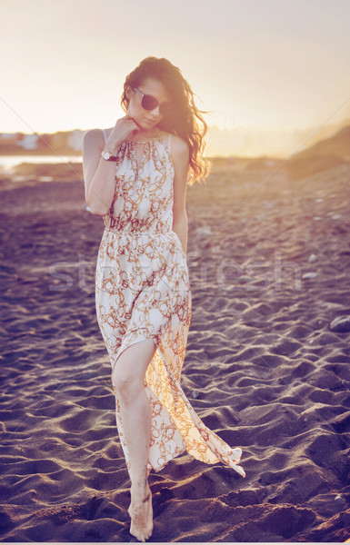 Modern style portrait of a beauty on an empty beach Stock photo © konradbak
