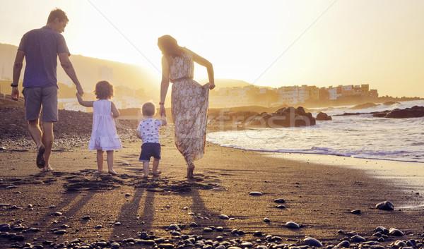 Relaxed family watching a beautiful sunset Stock photo © konradbak