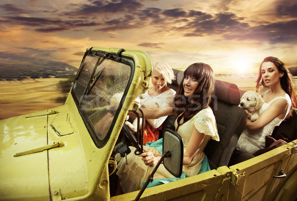 Adorable young ladies driving a cabriolet Stock photo © konradbak