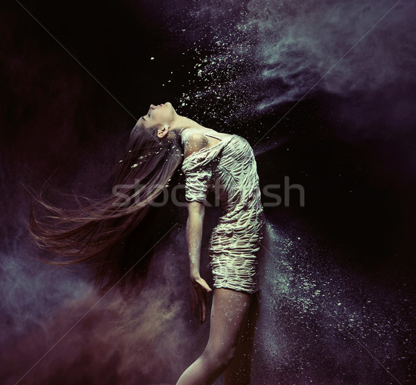 Young ballet dancer dancing with the dust Stock photo © konradbak