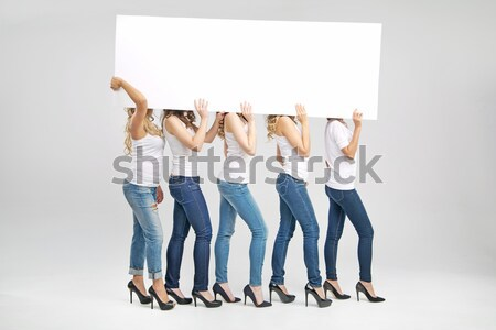 Portrait of attractive women promoting sale Stock photo © konradbak