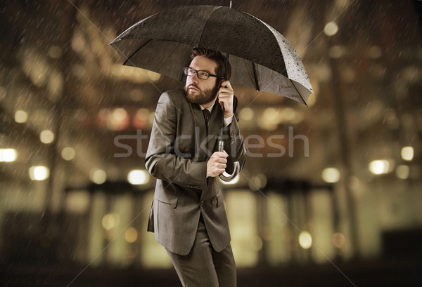 Afraid smart manager standing under the umbrella Stock photo © konradbak