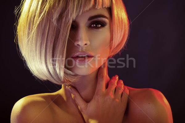 Portrait of the alluring woman with trendy coiffure Stock photo © konradbak