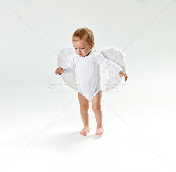 Portrait of a cute little baby angel Stock photo © konradbak