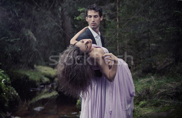 Elegant man carrying woman Stock photo © konradbak
