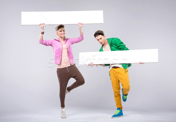 Stock photo: Cheerful teenagers wearing colorful clothes