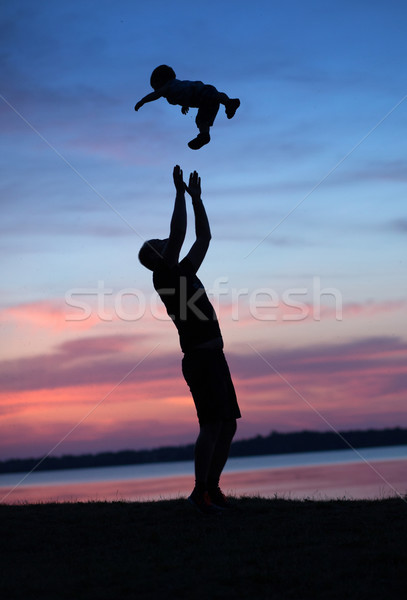 Father makes his baby happy Stock photo © konradbak
