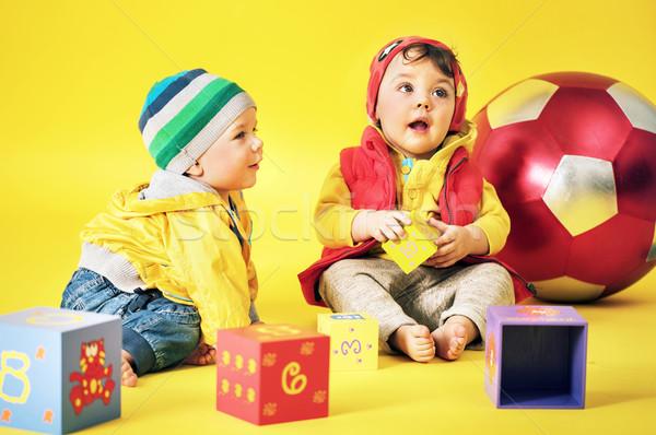Cute siblings playing toy bricks Stock photo © konradbak