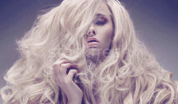 Portrait of a serious model with a fluffy coiffure Stock photo © konradbak
