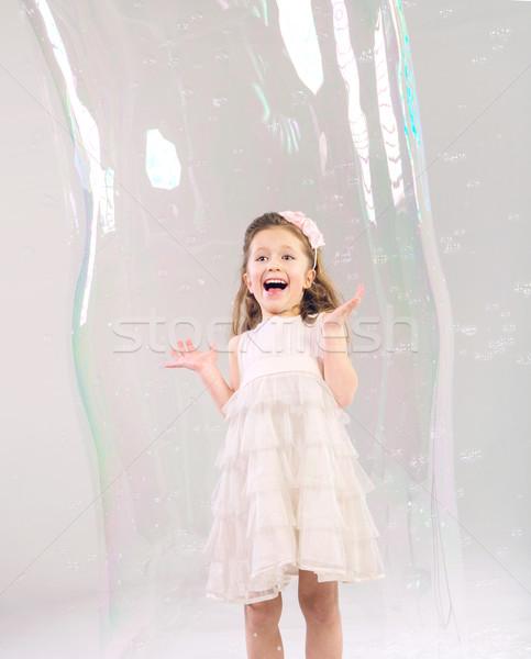 Aranyos gyermek nagy szappanbuborék lány boldog Stock fotó © konradbak