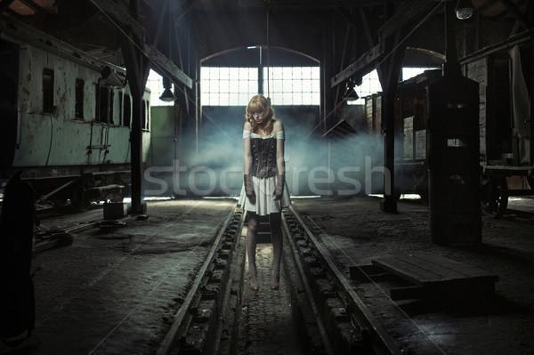 Artistic picture of the hung woman Stock photo © konradbak